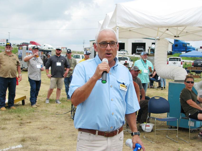After practice rounds, Thompson Tractor's Charlie Stevens provides a few announcements and gives the official air-horn start for timed and scored competitions.