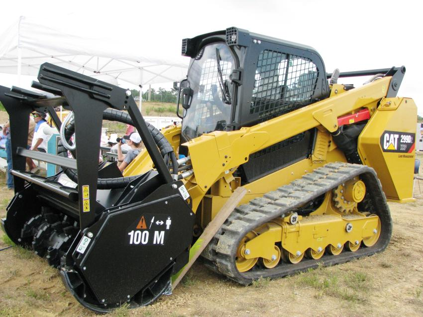 Cat machine displays were around the property, including this Land Management Cat 299D2 XHP with 100M forestry mulching head.