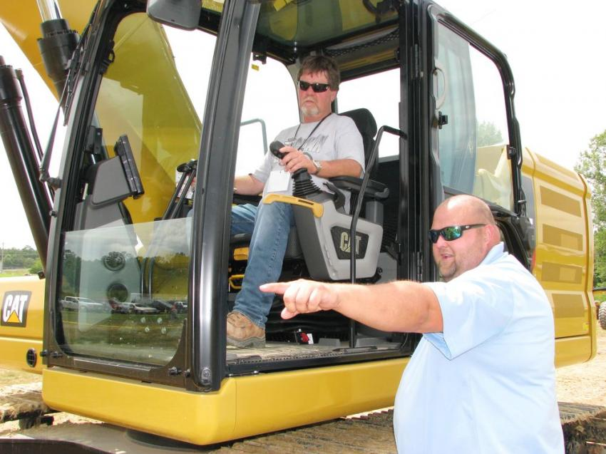 Danny Page (in cab) of the Alabama Surface Mine Commission gets complete instructions on the Cat 320 excavator challenge from Clayton Walley, Thompson Tractor certified dealer instructor.