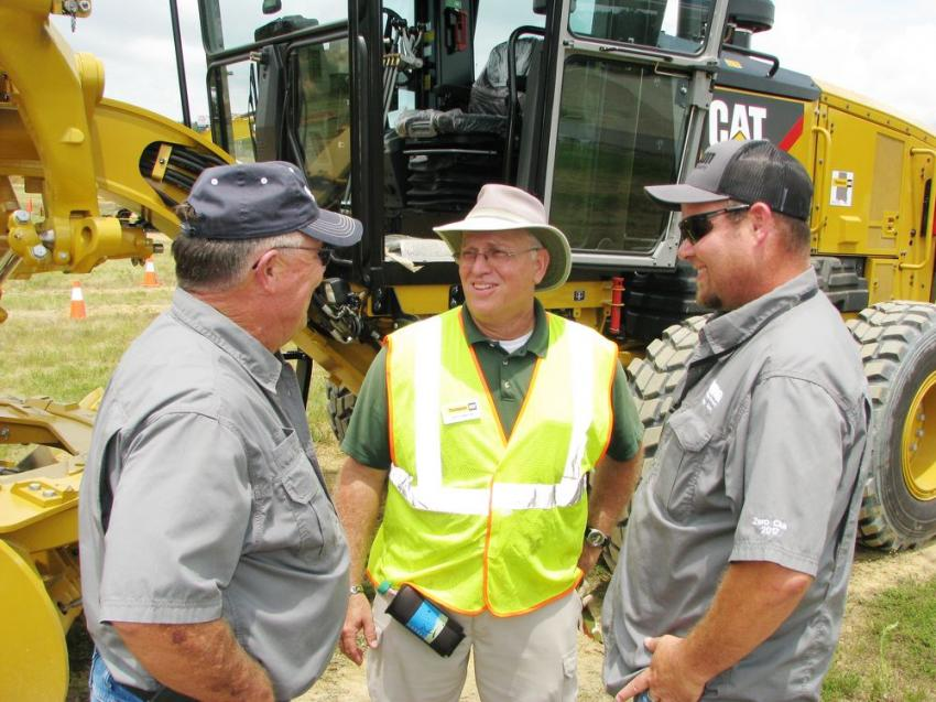 Enjoying the day's activities and having a few laughs before making a run at the motor grader challenge are Gene Massey (L) and Chad Price (R) of Vulcan Materials Company, Gurley, Ala., with Thompson Tractor's certified dealer instructor Jeff Smith.