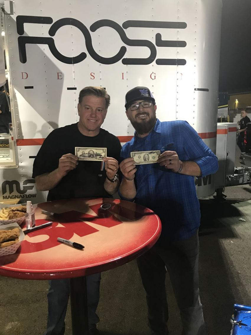 Chip Foose of Overhaulin' proudly shows off his $2 bill. Foose has his daughter, Katie's, first autograph that still resides in his wallet.