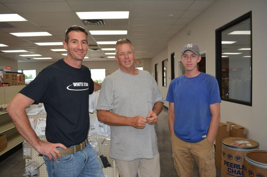 Tony Stafano (C) and Dylan Stafano (R) of Proper Care Lawn and Landscaping discuss the purchase of a Bobcat T595 track loader with Whitestar representative Mike Cologgi.