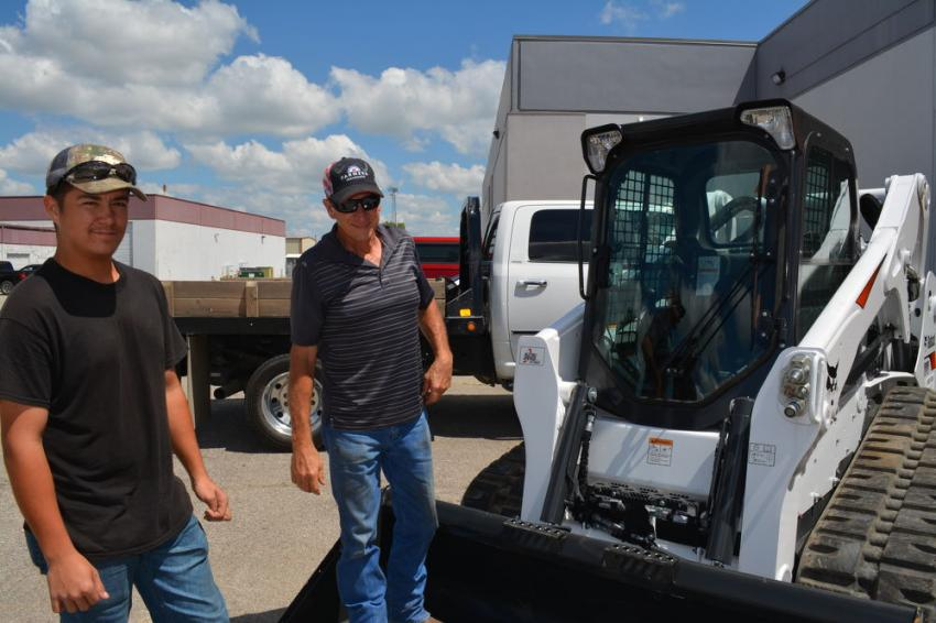 Billy Ewing (L) and Buddy Southerland, of Buddy's Bobcat Service, check out a Bobcat T650 that was on display during Whitestar Machinery's open house in Tulsa.