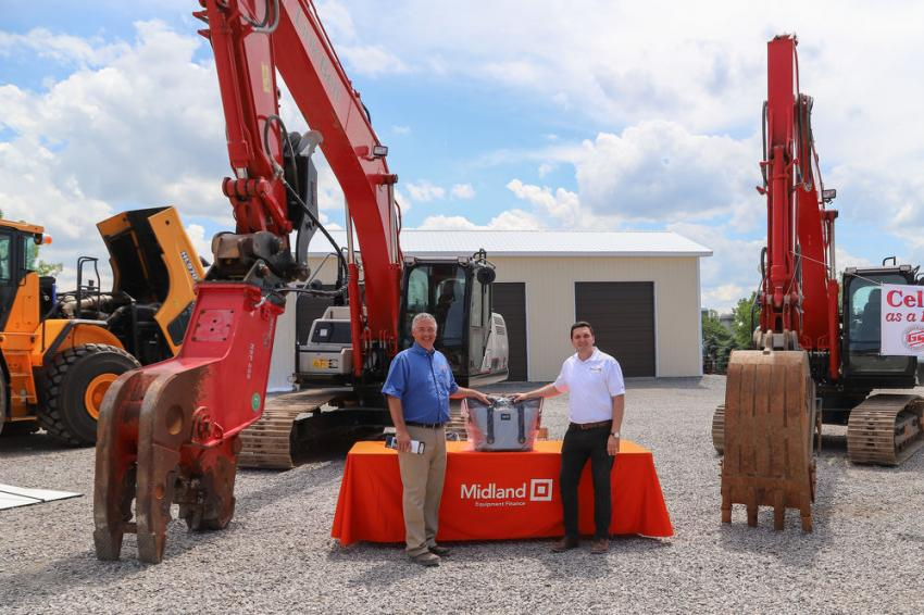 Greg Newell (L) of George & Swede and Anton Tikhonov of Midland Financial. Midland specializes in financing Link-Belt and Hyundai construction equipment.