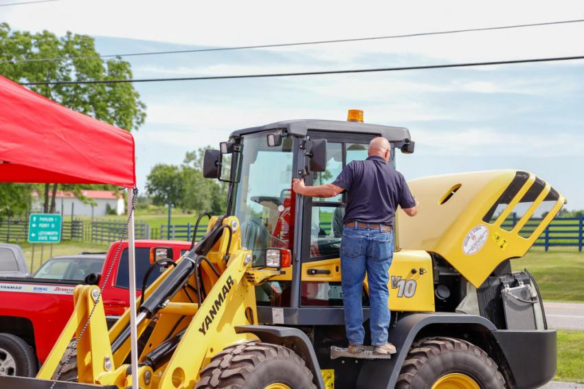 Scott Fisher, a George & Swede sales representative, does final machine preparations for the open house.
