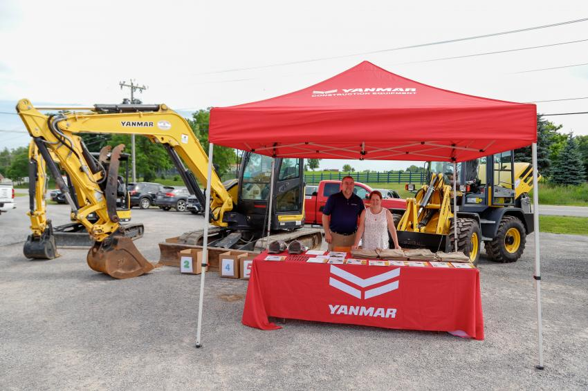 Rick Emery and his wife field questions from customers about the cutting-edge technology offered by Yanmar compact, earthmoving and excavating equipment.