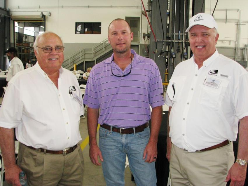 Gene Taylor (L) and Tom Tate (R) of Warrior Tractor give a warm welcome to the event to their friend and customer Ben Steltenpohl, vice president of operations — Alabama of Vulcan Materials.