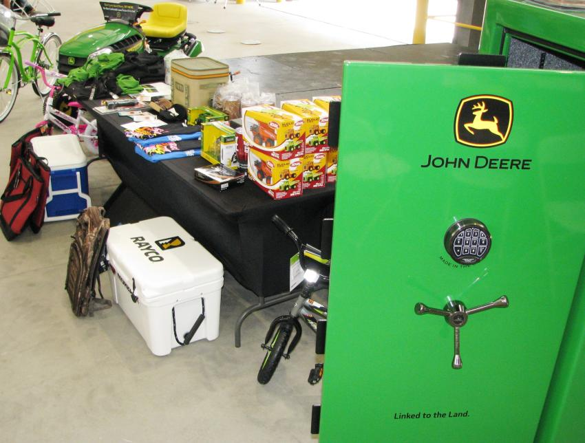 An absolutely amazing collection of prizes available at this event with two grand prizes of a John Deere Deluxe 23 series gun safe and a John Deere riding mower.