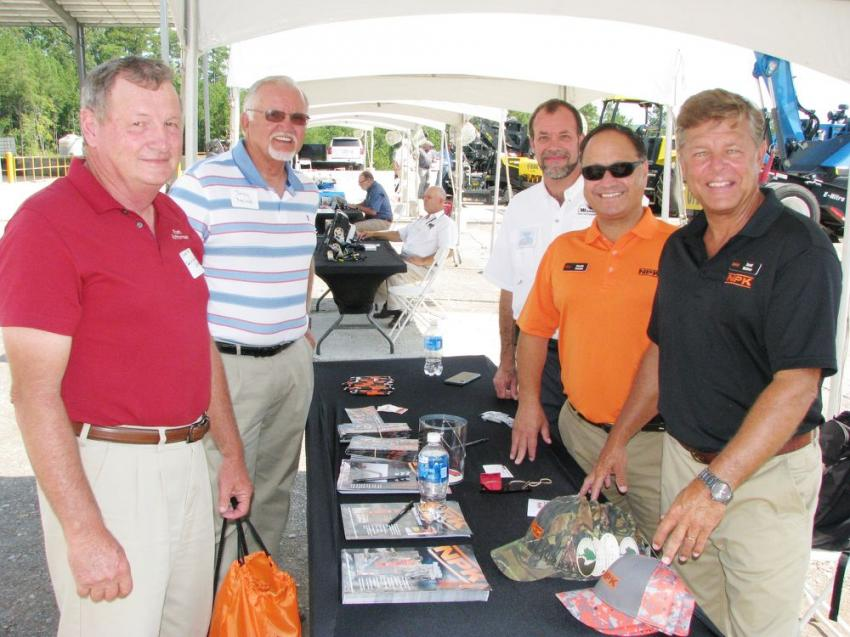 (L-R): In the vendor area at the NPK exhibit Charles Nix of the town of West Jefferson, Ala., and Johnny Ragland of the city of Warrior, Ala., stop to talk with Michael Hastings of Warrior Tractor and NPK's Claudio Calzado and Scott McEver.