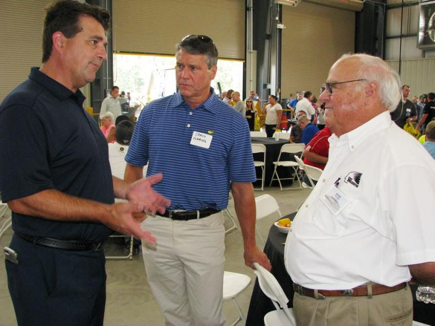 (L-R): Kelly Granatier, John Deere's U.S. and Canadian director of sales; Craig Fleming of Dunn Investment Company, Birmingham, Ala.; and Gene Taylor, owner of Warrior Tractor, talk about the beautiful new branch in Graysville, Ala.