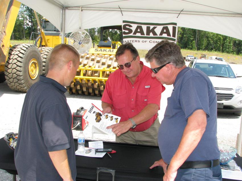 Daniel Wallace (L) of the City of Gardendale, Ala., Public Works Division and Rollie Tolbert (R) City of Centerpointe, Ala., Public Works have an in-depth conversation with Sakai America district manager John Wells about the Sakai products available at Warrior Tractor.