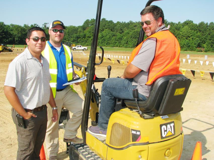 (L-R): Mike Saenz of Thompson Tractor — Panama City, Fla.; Kevin Muncher of Thompson Tractor — Birmingham, Ala.; and Jamie Carter of Carter Construction, Lynn Haven, Fla., talk about the Cat 300.9D mini-excavator challenge.