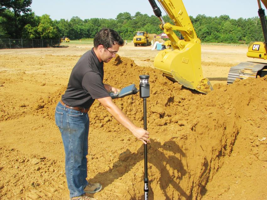 Tyler Phelps of SITECH South, Birmingham, Ala., checks the accuracy of the grading work performed by a contestant in the challenge.