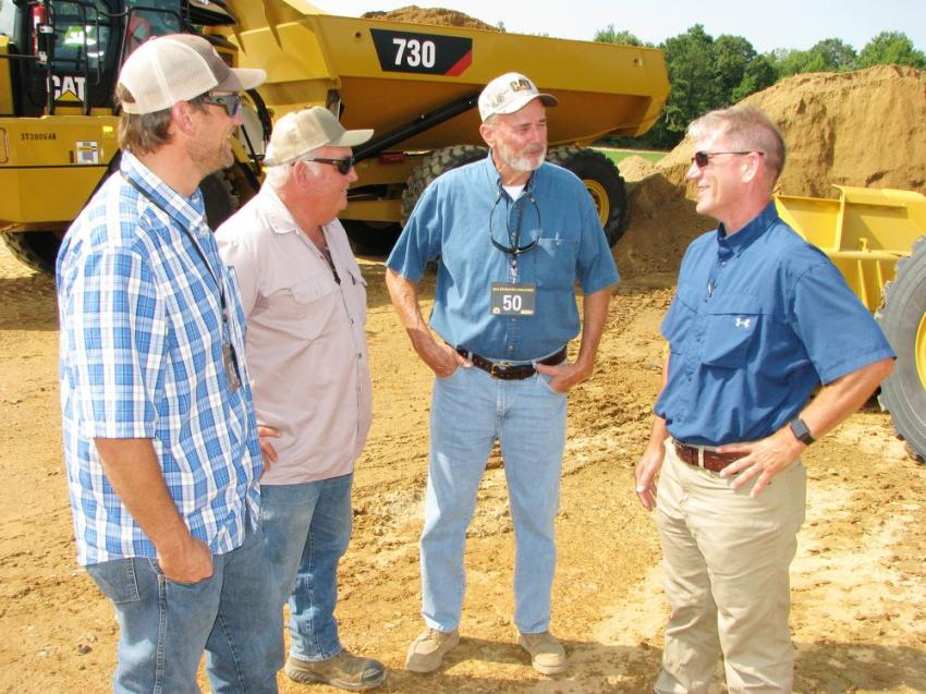 """Talking about the """"fully loaded"""" wheel loader competition (L-R) are Stephen Caddis of Civil Worx, Tuscaloosa, Ala.; Dan Law of Dan Law's Concrete, Baker, Fla.; Steve Cato of Cato Land Clearing, Crestview, Fla.; and Tommy Walker of Thompson Tractor — Crestview, Fla."""