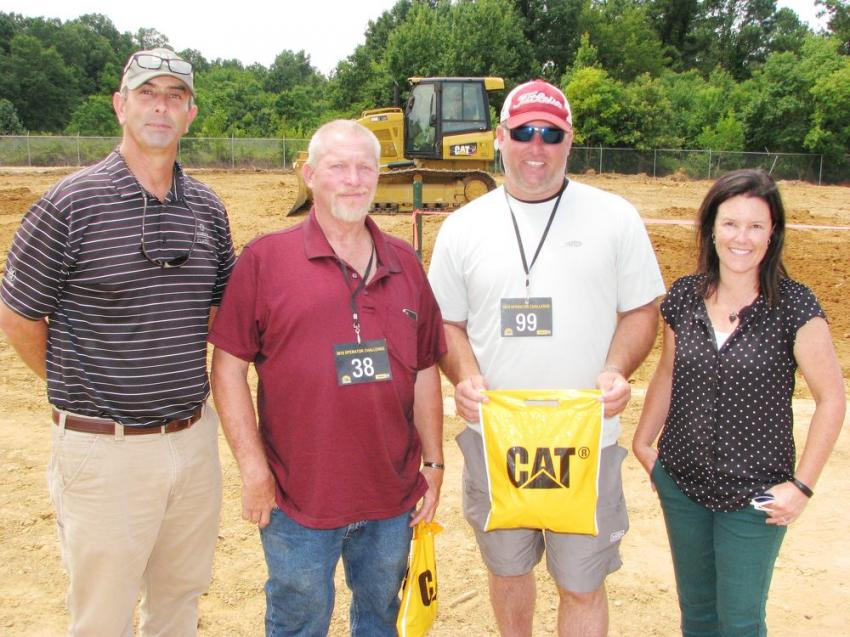 Enjoying some good conversation with customer-friends (L-R) are Rucker Brown of Thompson Tractor — Pensacola, Fla.; Ricky Butler and Matt Arrington of Arrington Curb & Excavation, Flomaton, Ala.; and Lucy Thompson Marsh of Thompson Tractor — Birmingham, Ala.