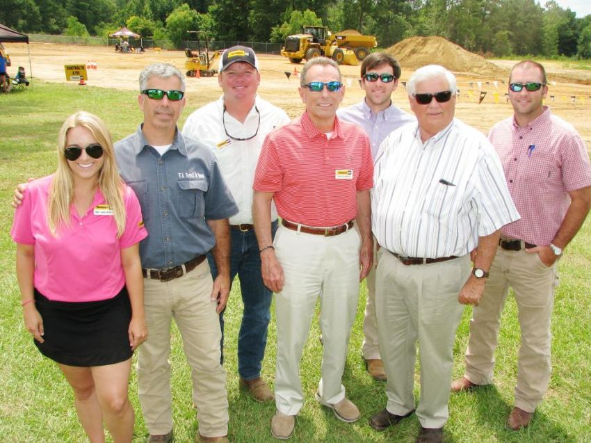 A big crowd from W.S. Newell & Sons in Montgomery, Ala., made their way to the event to join their friends. (L-R): Emily Anne Newell of Thompson Tractor and her dad Keith Newell of W.S. Newell; Hardy Traylor and Skip Plumlee of Thompson Tractor; Mitchell Newell, Sam Newell and Justin Evers of W. S. Newell.