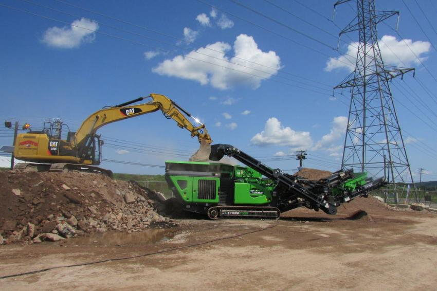A Caterpillar 320E excavator loads a Cobra 230R during the demonstration event.