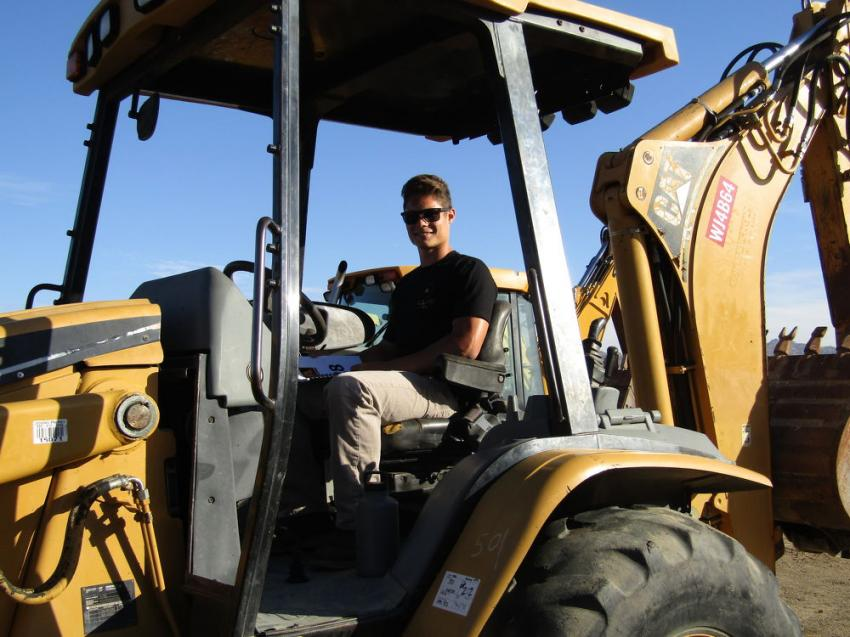 Jake Perry of Ventura, Calif., tests the maneuverability of this Cat backhoe.