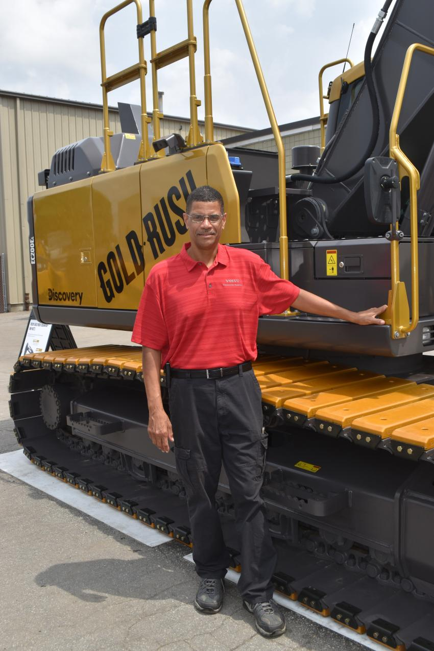Eric Dalton of Keen Transport Inc. is very proud of his unique opportunity to be the Gold Rush excavator's caretaker and body guard as he hauls his Volvo tractor and Rogers trailer loaded up with the one of a kind Gold Rush excavator to dealer events all across the country.