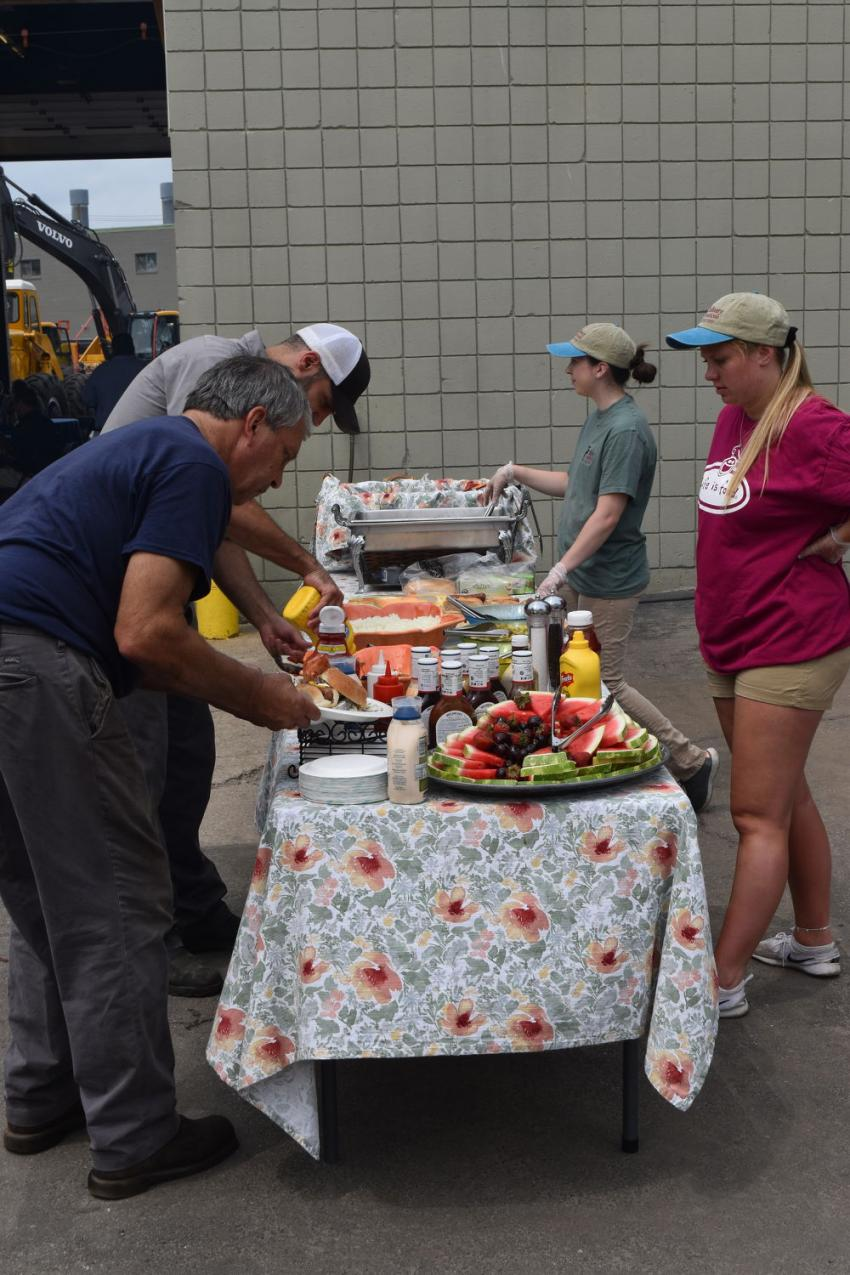 Open house attendees enjoy a delicious barbecue lunch compliments of Woodco Machinery.