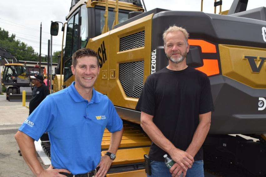With a Gold Rush excavator are Jim Carey (L) of Woodco Machinery and Dave Clark, service manager of Emerald Excavating in Plymouth, Mass.
