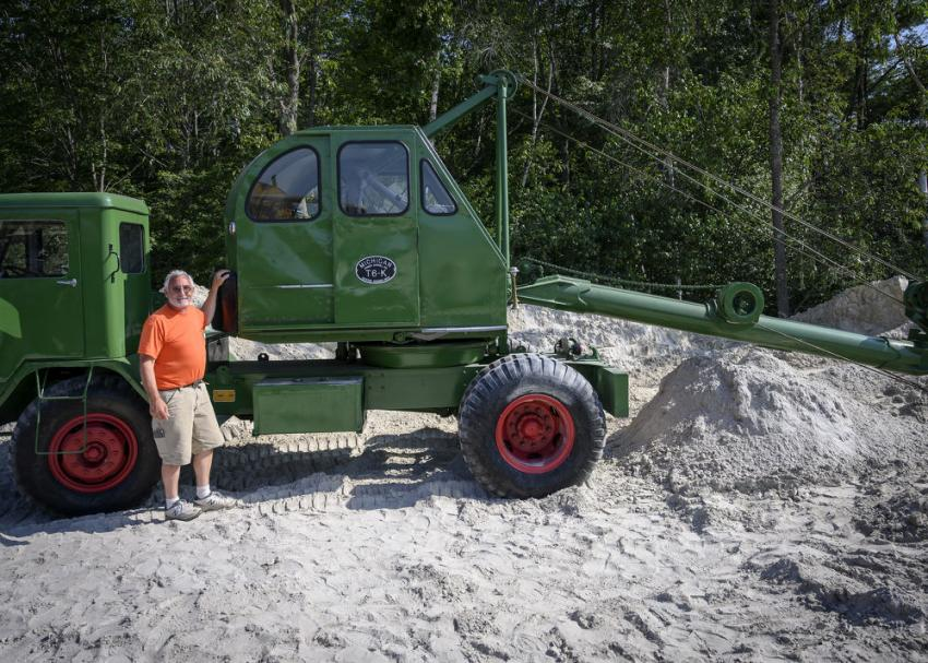 Five-year member Dave Nichols in front of a 1951 Michigan T6-K power shovel.