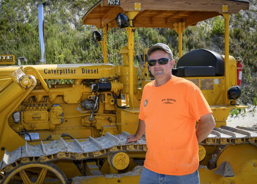 Steven White shows off his restored 1956 Caterpillar V6-9U cable dozer.
