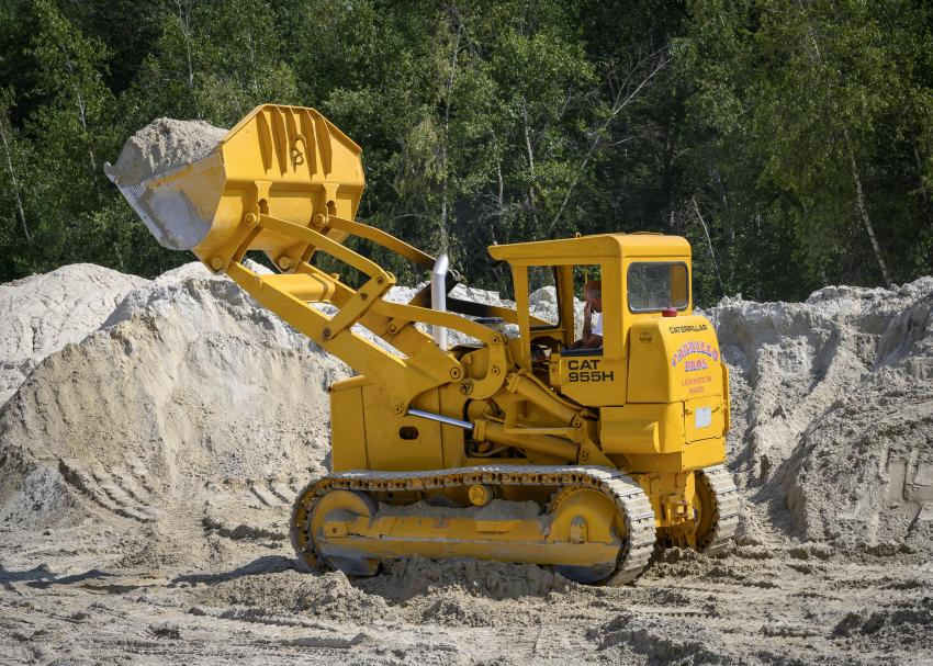 A member operates a 1966 Caterpillar 955H track loader.