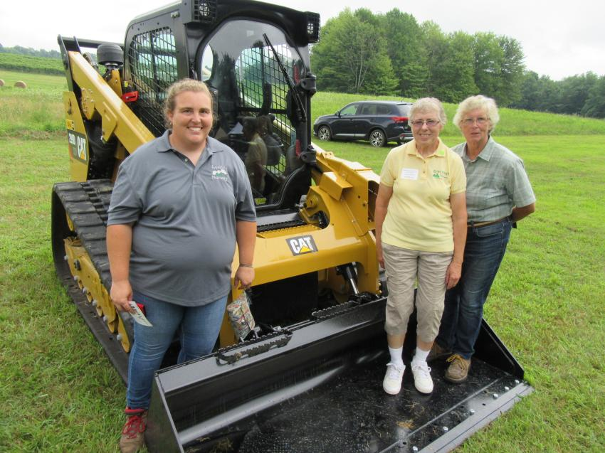 Samantha Harless of Losely Nurseries, Barb Zupcsan of Zupcsan Nurseries and Ruth Robson, also of Losely Nurseries, review Ohio Cat's Caterpillar 299D2 tracked compact loader on display.
