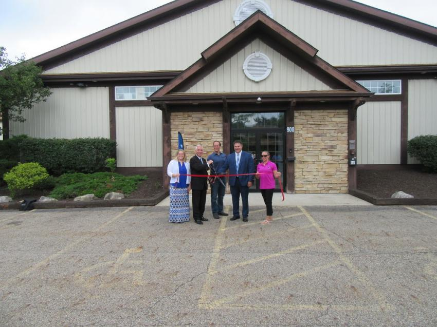 (L-R): Chamber of Commerce Executive Director Jaclyn Ringstmeier; Medina Mayor Dennis Hanwell; Okada America Inc. President Jim Brown; Sharon Township Trustee Joe Canestraro; and Devon Diello, membership and events coordinator of the City of Medina Chamber of Commerce, cut the ribbon to commemorate Okada America's expansion and facility upgrades.
