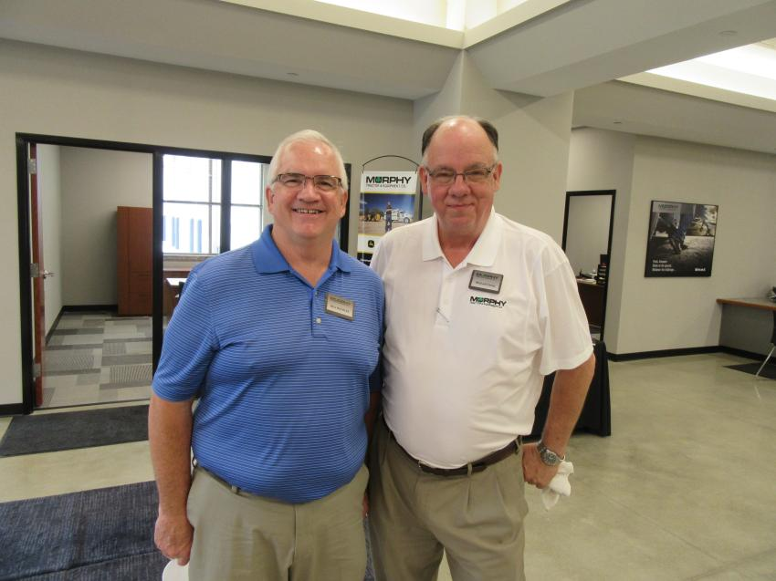 Murphy Tractor & Equipment Co. President Bill Buckles and Michael Camp, area sales manager, welcome attendees to the company's Brunswick branch grand opening celebration.