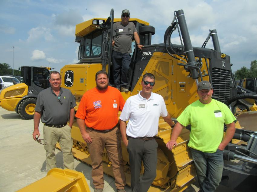 (L-R): Kirk Scheid of Scheid Enterprises joined John Deere's Matt Hendricks, Chris Benedict of CB Excavating & Trucking, Ethan Irish of Murphy Tractor & Equipment Co. and Jason Scheid, also of Scheid Enterprises, to review this John Deere 850L dozer in the equipment yard at the event.