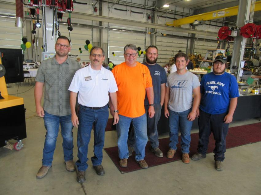 (L-R): Mike Switzer of Stevens Engineering & Constructors joined Murphy Tractor & Equipment Co.'s Kent Seward, along with Stevens Engineering & Constructors' Curt Survance, Andrew McCall, Nick Mroczynski and Cody Reed to celebrate the grand opening of Murphy Tractor & Equipment Co.'s Brunswick branch.