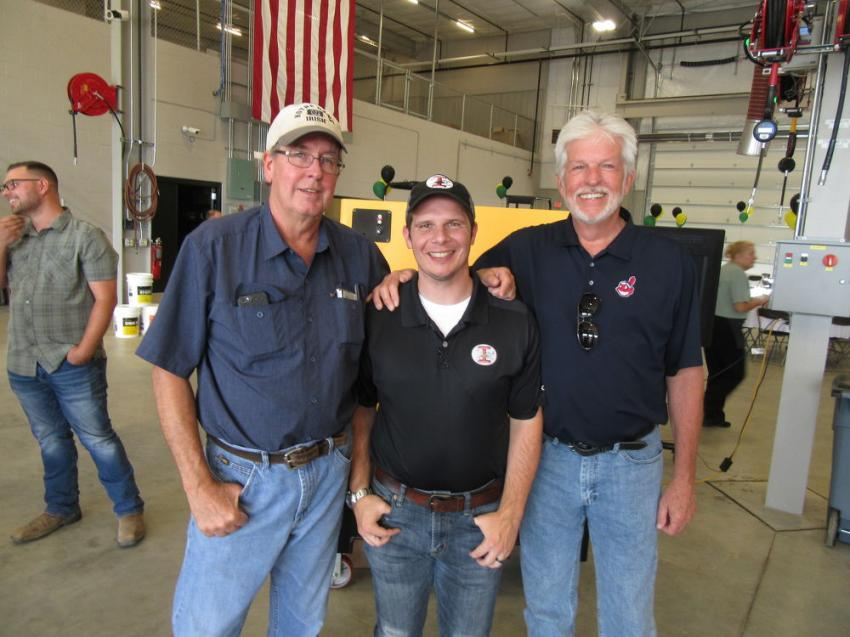 (L-R): Terry Tomasko and Evan Stephens of Independence Excavating Inc., along with Evan's father, Bob Stephens, who recently retired, stopped by to celebrate the grand opening of Murphy Tractor & Equipment Co.'s Brunswick branch location.