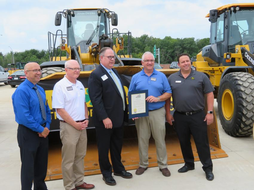 Bill Buckles, president of Murphy Tractor & Equipment Co. (second from 	R), receives a proclamation from Grant Aungst, community and economic development director of Brunswick, Ohio. Also pictured are Carl DeForest, Brunswick city manager, Mike Slinger, Midwest regional director — Murphy Tractor & Equipment Co. and Mark Favetti of John Deere (far R).