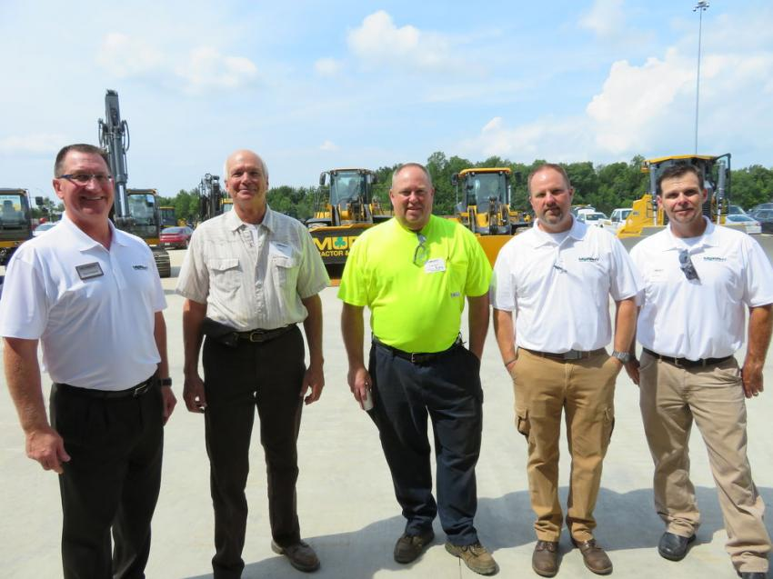 Enjoying the open house in Brunswick, Ohio, are Marty Hlawati of Murphy Tractor & Equipment Co.; Fred Kiehl, president of Kiehl Building Services; George Benner of Kiehl Building Services; and Chris Mears and Bob Yeager, both of Murphy Tractor & Equipment Co.