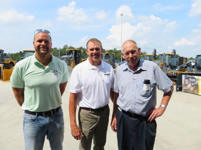 Curt Thomas of Murphy Tractor & Equipment Co. shows the new Brunswick, Ohio, location to Bob Jones (L) of Ritchie Bros .and Matt Burda (R) of Great Lakes Construction.