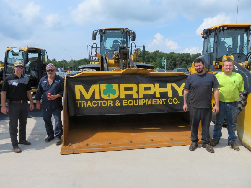 Looking over the John Deere wheel loader lineup at the open house are Tyler Macali, Paul Smith, Ed Alexander and Cory Maple, all of Great Lakes Construction.