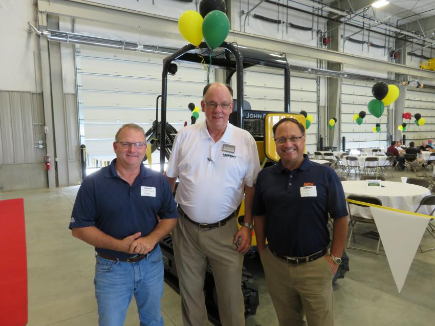 Michael Camp, area sales manager of Murphy Tractor & Equipment Co., welcomes Kevin Edwards (L) of the Shelly Co.  and Claudio Calzado (R), vice president of sales, NPK Construction Equipment Inc.