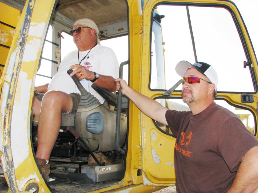 Dwayne Case (in cab), a farmer based in Brookhaven, Miss., and contractor David Mize  from Natchez, Miss., had a couple of dozers they liked and planned to bid on at this sale.