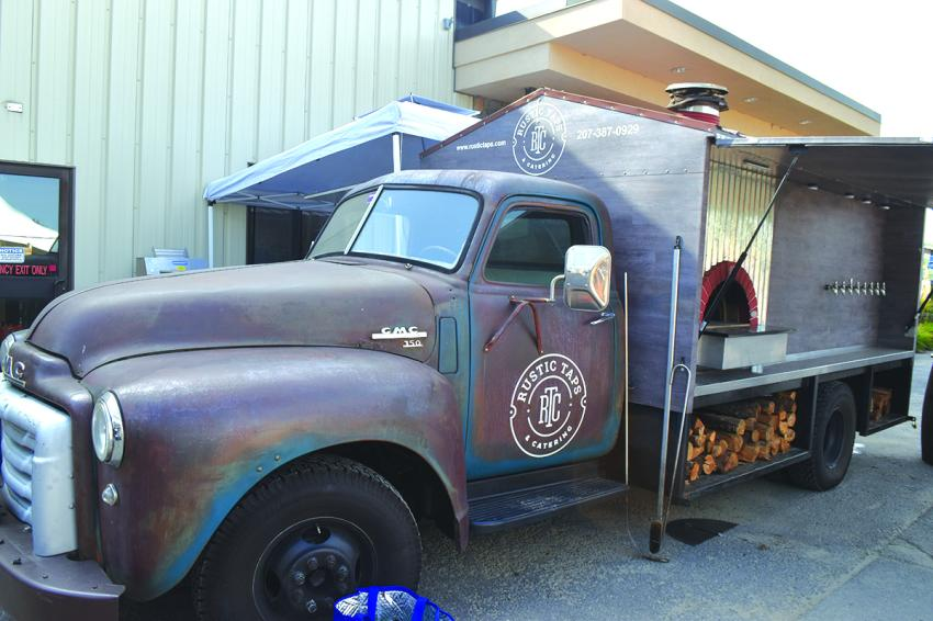 This GMC 150 truck has been converted into a pizza oven and beer tap system.