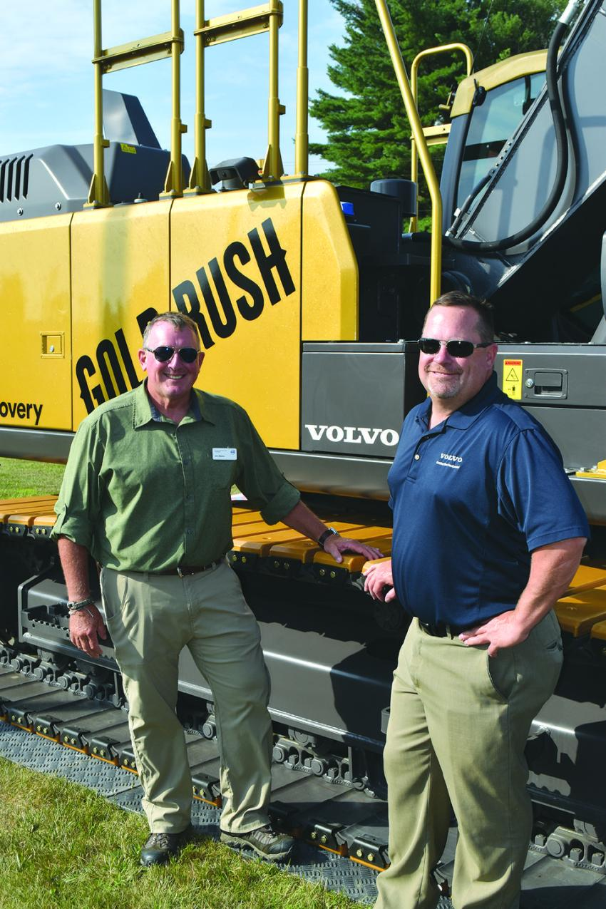 Traveling with the Gold Rush excavator during the New England segment of its tour are John Waldron (L) and Craig Newbold, both Volvo district sales managers.