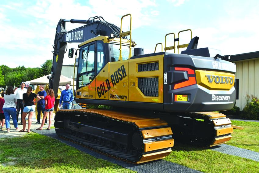 Crowds gather around to admire the Volvo EC200E Gold Rush excavator that is currently on tour visiting Volvo dealerships across the United States.