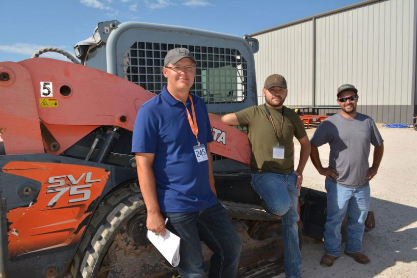 (L-R): Cotton and peanut farmers David Fehr, Jacob Martens and Peter Froesse all seemed interested in the  SVL 75 track loader.