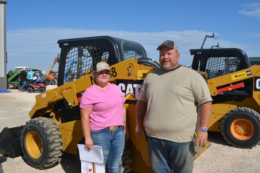 Ranchers Autumn and David Hines of Lovington, N.M., were shopping for a skid steer to be put to use on Blue Moon Ranch. They would later bid on the Cat 246D.