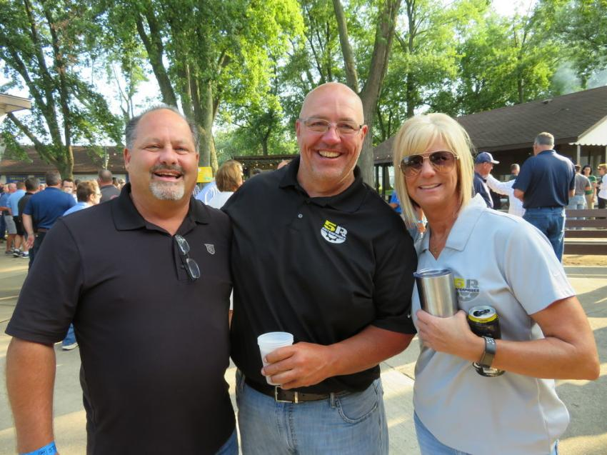 "(L-R): Kenny Sandeno, president of ""D"" Construction Inc., with Chad Cailteux, owner of 5R Enterprises, and Julie Tarter, executive assistant of 5R Enterprises."