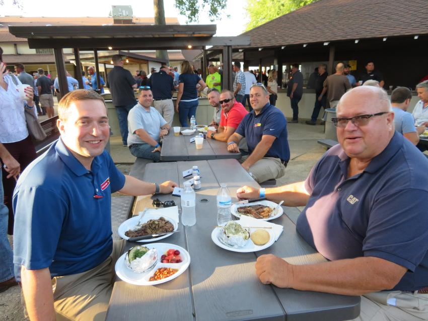 (L-R): Todd Walkup, Josh Carter, Bob Czarnowski, Brandon Fox, Dan Motchnik and Tony Mattingly, all of Altorfer Cat, enjoy a delicious steak cooked by volunteers from the CAWGC at the organization's annual Steak Fry.