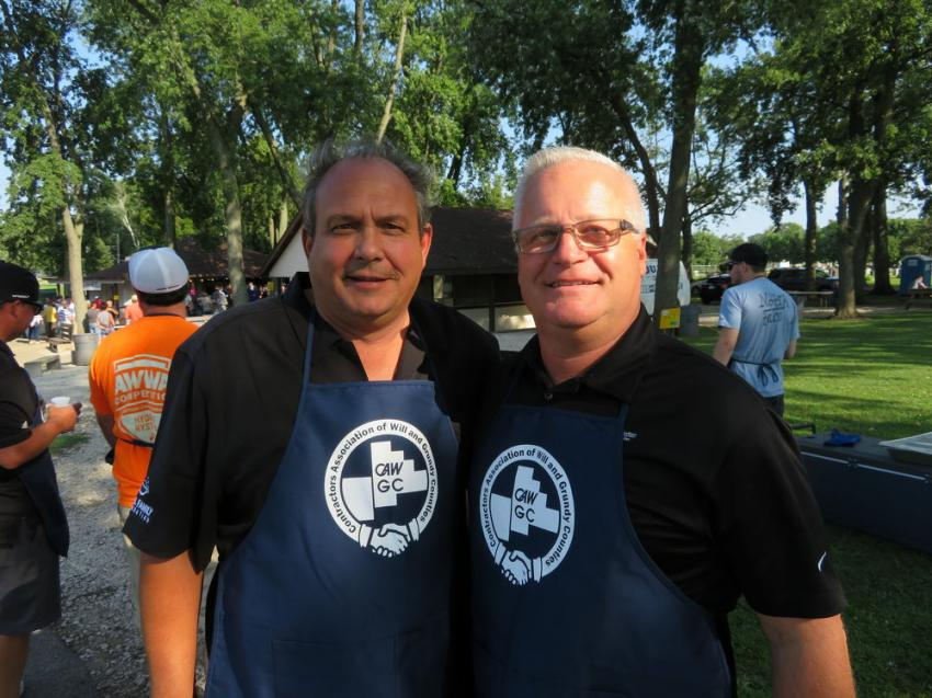 John Young (L) of Seasons Landscaping Inc. (and CAWGC board member) and Steve Costello of McCann Industries, Inc. both have been volunteering as grill masters for more than 22 years at the annual Steak Fry.