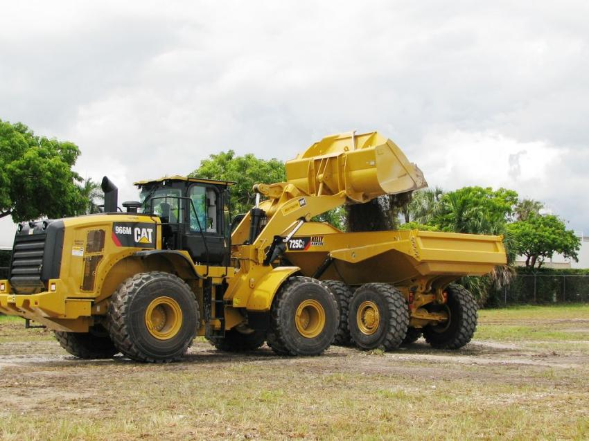 "A contestant in the ""Fully Loaded"" challenge operates a Cat 966M wheel loader and attempts a perfect 22-ton load onto a Cat articulated truck using payload scale technology on the loader."