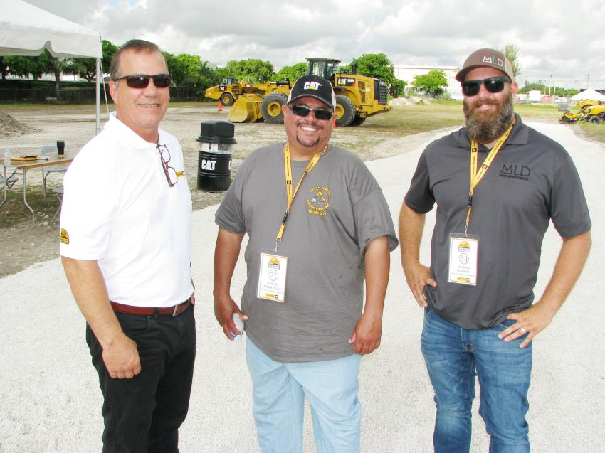 (L-R): Tony Allanic of Kelly Tractor talks with Carlos Rodriguez, South Florida Excavating, Miami, Fla., and Shawn Murray, Murray Land Development, West Palm Beach, Fla., about their runs at each of the challenges.